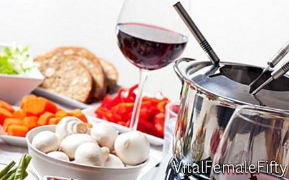 Fondue - Swiss specialty in melted cheese
